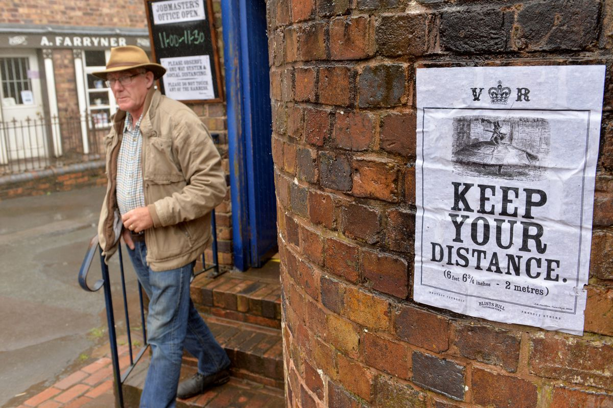 Victorian-style posters remind visitors about social distancing guidelines