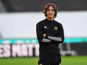Fabio Silva of Wolverhampton Wanderers checks out the Molineux surface before the game against Manchester City.