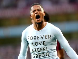 """Aston Villa's Leon Bailey reveals a shirt paying tribute to Steffie Gregg as he celebrates scoring their side's third goal of the game during the Premier League match at Villa Park, Birmingham. Picture date: Saturday September 18, 2021. PA Photo. See PA story SOCCER Villa. Photo credit should read: Tim Goode/PA Wire.   RESTRICTIONS: EDITORIAL USE ONLY No use  with unauthorised audio, video, data, fixture lists, club/league logos or """"live"""" services. Online in-match use limited to 120 images, no video emulation. No use in betting, games or single club/league/player publications."""