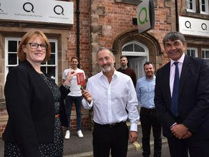 Morris Property's Liz Lowe, Q Financial's Mitchell Gough and Towler Shaw Robert's Toby Shaw with the wider Q team behin - Dave Edwards, Stuart Mackintosh and Steve Parry
