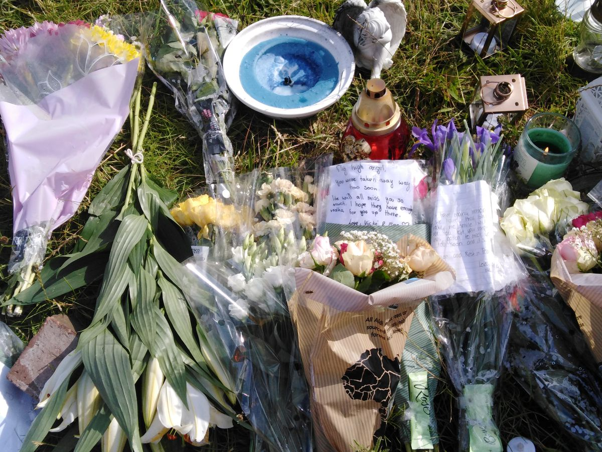 Tributes left at the roadside where Dawid Kurdziel was found