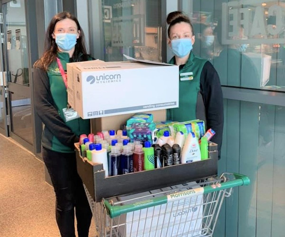 Rachael Roberts and Kiley Waters, Morrisons Community Champions, with the toiletries donated by the public