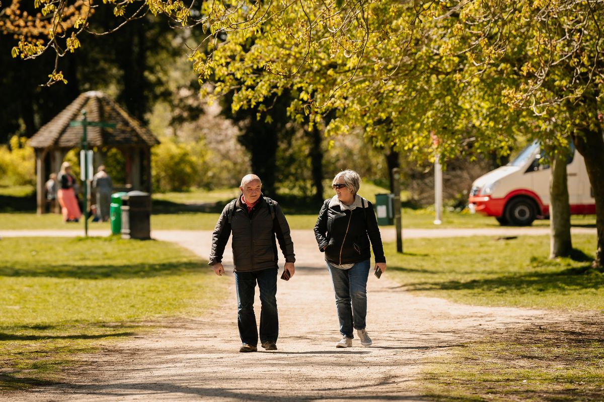 People walking at The Mere in Ellesmere