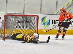 Telford Tigers' Scott McKenzie slots home to secure a penalty shootout success against Bracknell Bees (Picture: Steve Brodie)