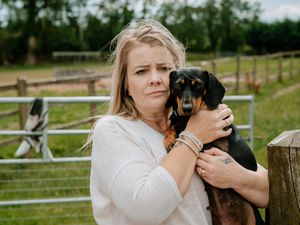 Keri Jones, with Duchess. Her other dogs were stolen during a night-time raid.