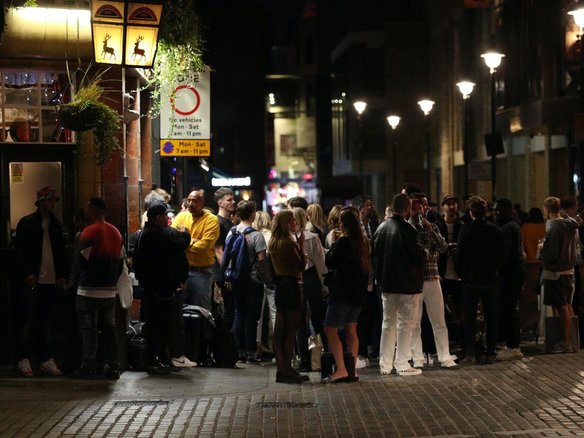 People outside the Blue Posts pub in Berwick Street, Soho