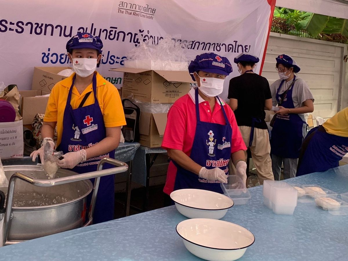 Oswestry School pupils Great and Grand Boonlert, 15 and 13 respectively help out in The Royal Kitchen, Bangkok