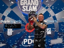 Brilliant Gerwyn Price retains Grand Slam of Darts title