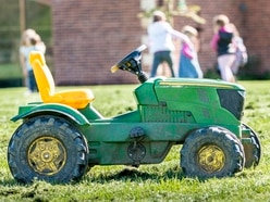 Missing toddler had driven himself to local fair on toy tractor