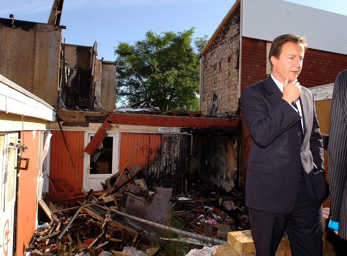 You may have noticed that David Cameron has got a book out, so let's shine the spotlight on him during a visit to Shropshire in August 2008. Here is the Conservative leader outside a burned-out house in Sutton Hill, Telford. Mr Cameron toured the estate after a meeting with about 20 residents, all members of a local working party set up to look into a planned regeneration of the estate.