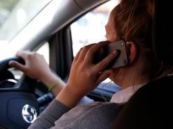 Big fall in drivers using mobile phones - but 1,400 still caught by police
