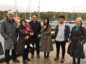 Frishta, her husband Murtaza, baby Kia, Farzana and their brother Zaker, with John and Lorna Norgrove