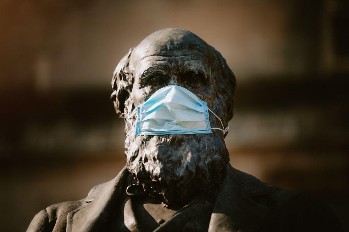 Charles Darwin statue in Shrewsbury wearing a mask during the coronavirus pandemic