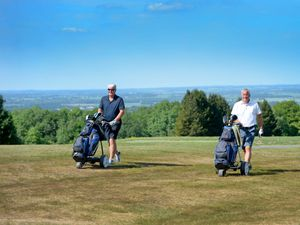 LAST COPYRIGHT EXPRESS&STAR TIM THURSFIELD-02/06/20.Golf clubs are allowed to play four balls again. Pictured social distancing at Wrekin Golf Club are Terry Brentnall and David Dudley..