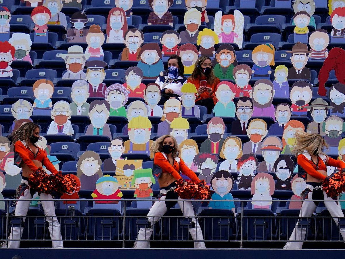 Denver Broncos cheerleaders perform as two fans sit among cardboard characters from the show South Park during the first half of an NFL football game against the Tampa Bay Buccaneers, Sunday, Sept. 27, 2020, in Denver