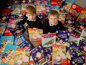 Youngsters Charlie and Liam Randall, four and eight, have been collecting advent calendars for others with their mother Lorraine this year. The calendars, 108 in all, will go to the Market Drayton Foodbank and the Alice Charity of Newcastle-under-Lyme