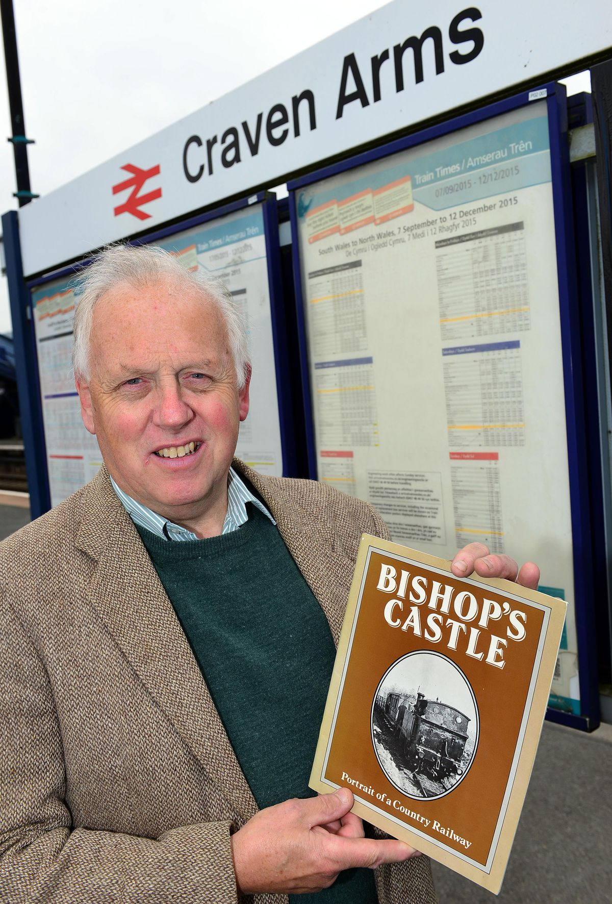 John Rimmer with one of Bishop's Castle Railway Society's books at the Craven Arms end of the line