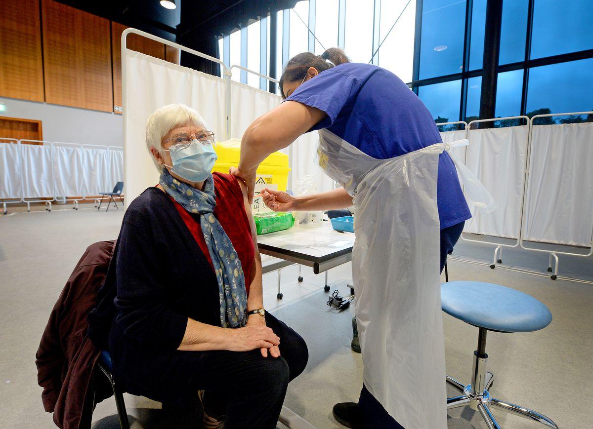 Marian Thomas, 80, of Wellington, gets her jab from staff nurse Ruby Mander
