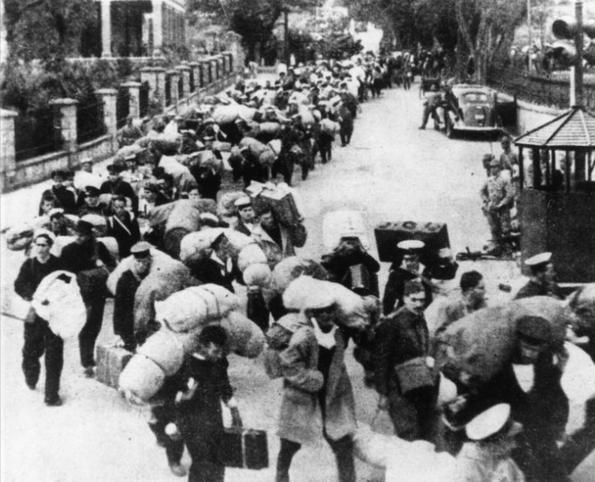 British prisoners being marched into captivity in Hong Kong in December 1941