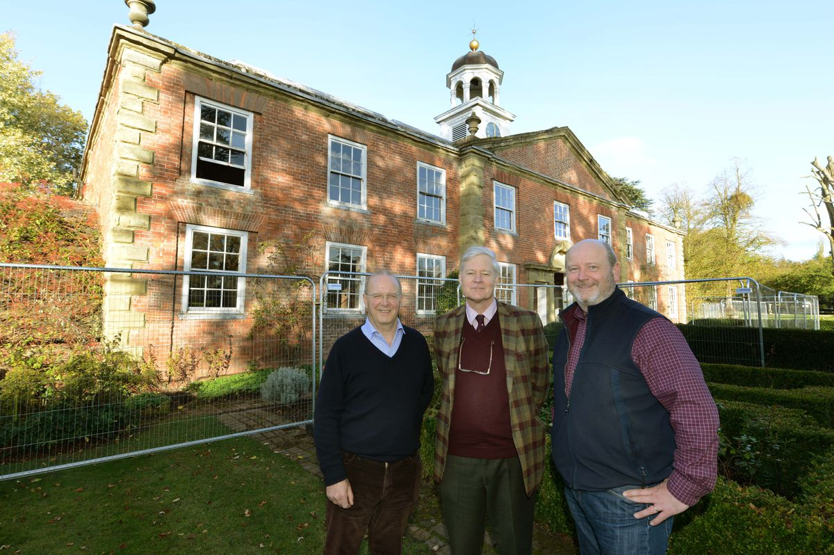 Mark Van Oss, Project Director, Architect, Craig Hamilton and Landscape Architect Christian Sweet in front of the Coach House in Mawley Hall