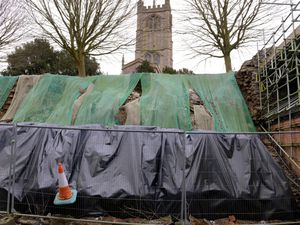 It is eight years since a portion of the wall behind St Laurence's Church collapsed