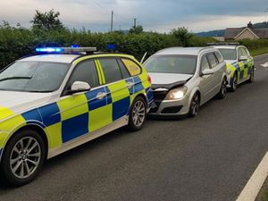 The Vauxhall Astra was boxed in by two police cars, both of which were damaged. Photo: Dyfed-Powys Police