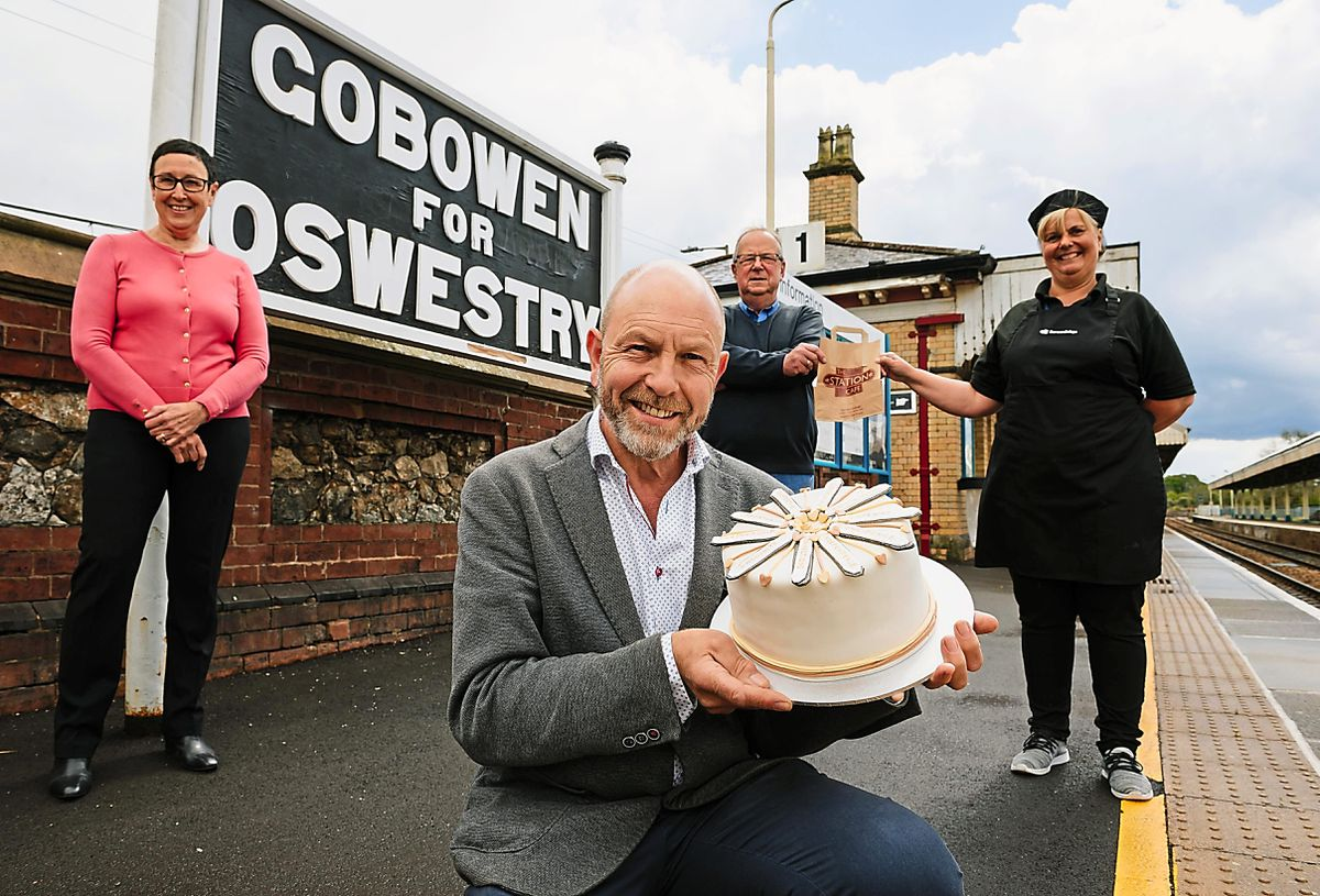 Shelia Dee, Pete Evans, Tony Dart and Teresa Richards with the specially-made cake at Gobowen Station and cafe