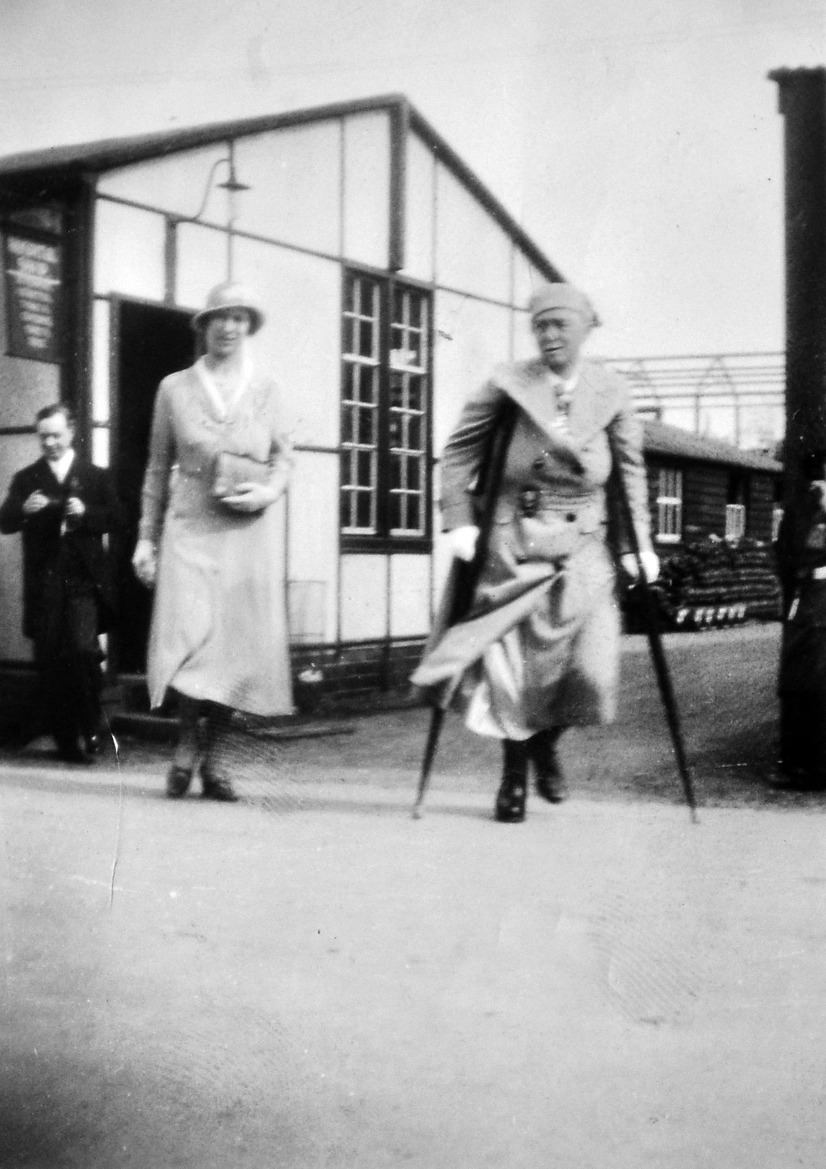 Agnes on her crutches during a visit by the Princess Royal.