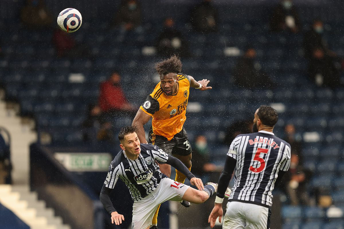 Adama Traore of Wolverhampton Wanderers wins a header against Conor Townsend of West Bromwich Albion. (AMA)