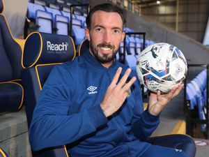 Ryan Bowman of Shrewsbury Town celebrates scoring a hat trick in Town's 4-1 win with the match ball signed by all of his team mates (AMA)