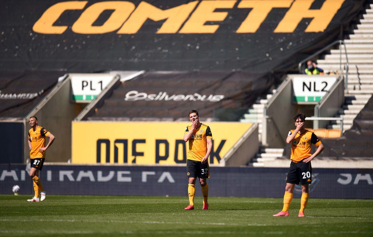 Wolverhampton Wanderers players appear dejected