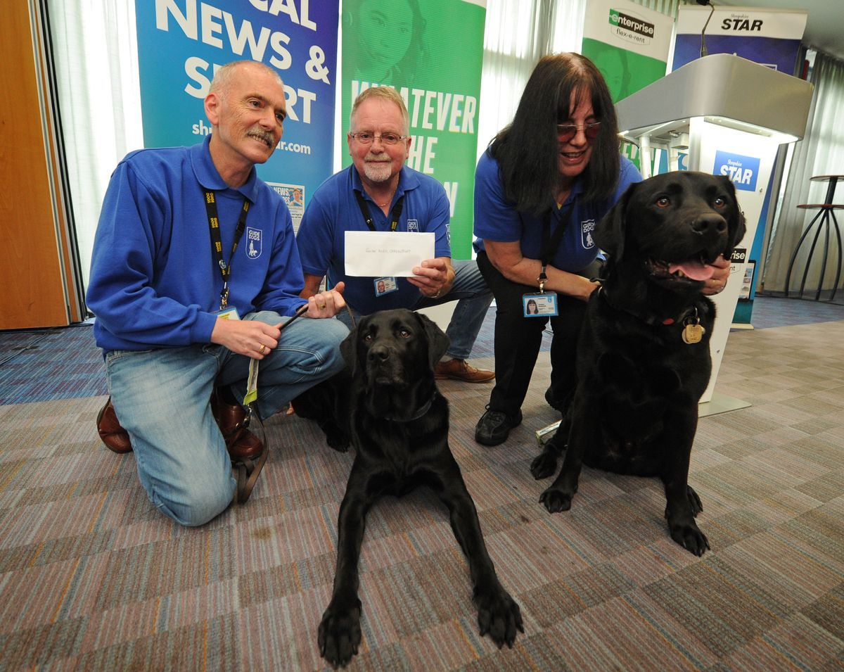 Darren Clutton, with 'Quincey', Robert Corfield and Lindsey Rowlands, with 'Leyland', of Shrewsbury Guide Dogs