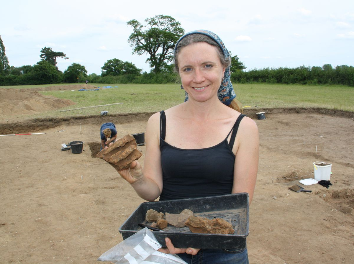 Janine Young with some of the wattle and daub