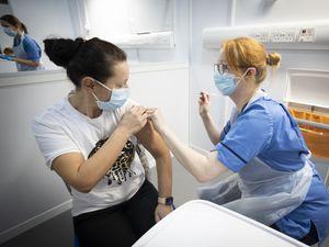A nurse administers the coronavirus vaccine
