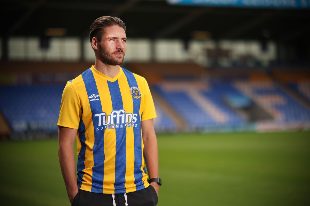 Shrewsbury's new left-back Luke Leahy is modeling the city's new home kit - and first with new Umbro suppliers - for the upcoming campaign.  (AMA)