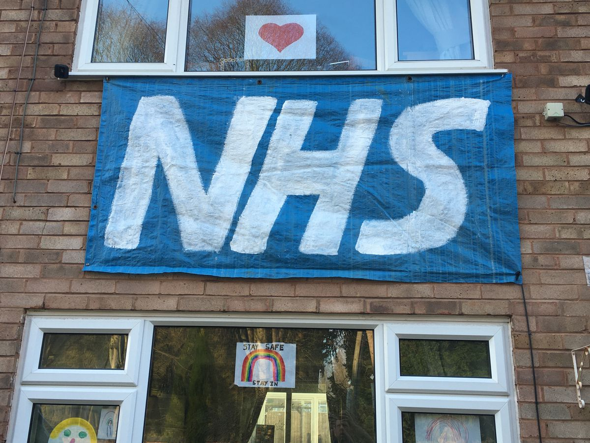 Phil and Teresa Harrison decorated their house in Wombridge with this banner, with the help of their five and seven-year-old boys Bradley and Theo