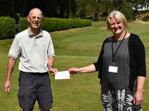 Handing over the cheque was Peter Freegard from Church Stretton's Golf Club to Mayfair's Chief Officer, Nicola Daniels