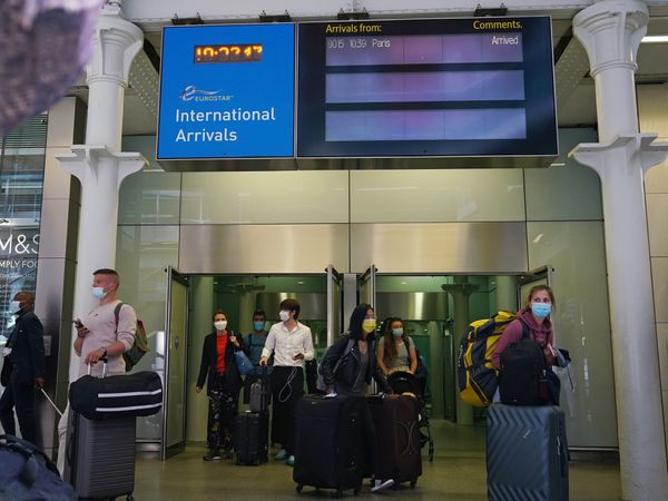 Travellers arriving from France on the Eurostar at St Pancras International railway station in London