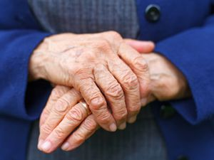 Close-up picture of an old woman's hands.