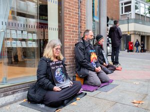 Buddhists protested against Barclays investment in fossil fuels in Shrewsbury. Pics: Richard Hammerton