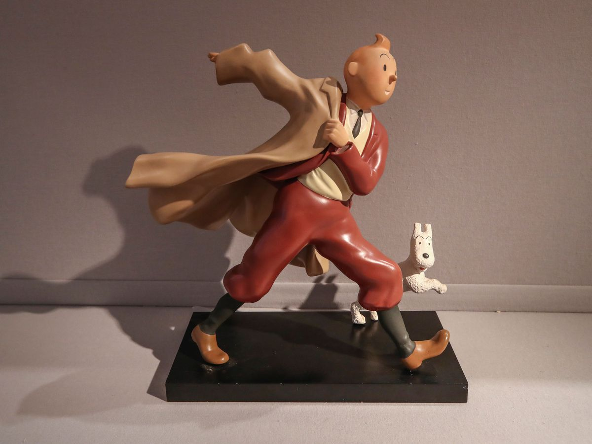 A 1988 polychrome resin sculpture of the comic character Tintin and his dog Snowy (Michel Euler/AP)