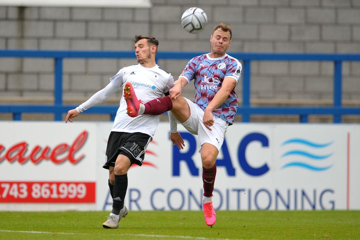 Jordan Davies battles for the ball