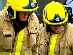 Firefighters free man from under car near Newport