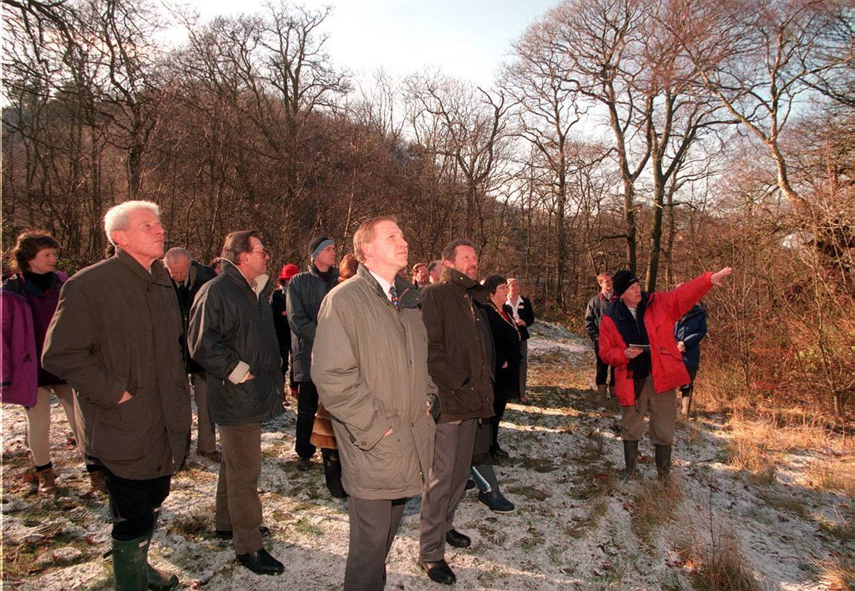 Geologist Peter Toghill, far right, points out the geology of the Ercall site in February 1999.