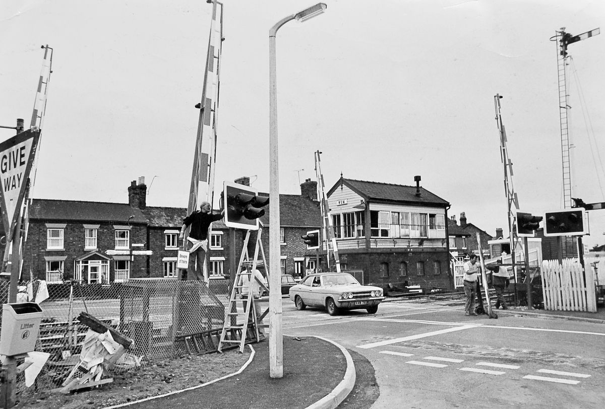 """A new level crossing was taking shape in Wem on September 18, 1979. The original caption to this picture from our files said: """"Wem has taken a continental look – at least as far as the trains are concerned. The weekend saw the end of the traditional gates at the level crossing at Wem and the new-style continental barriers are being put in their place, and are now in use by traffic."""""""