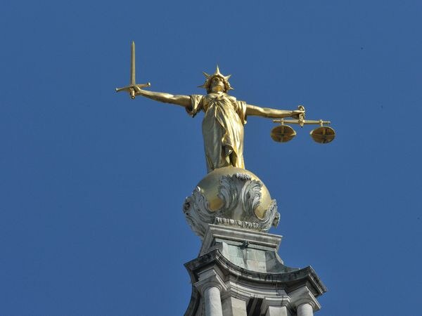 The Lady Justice statue atop the Central Criminal Court, also referred to as the Old Bailey (Nick Ansell/PA)