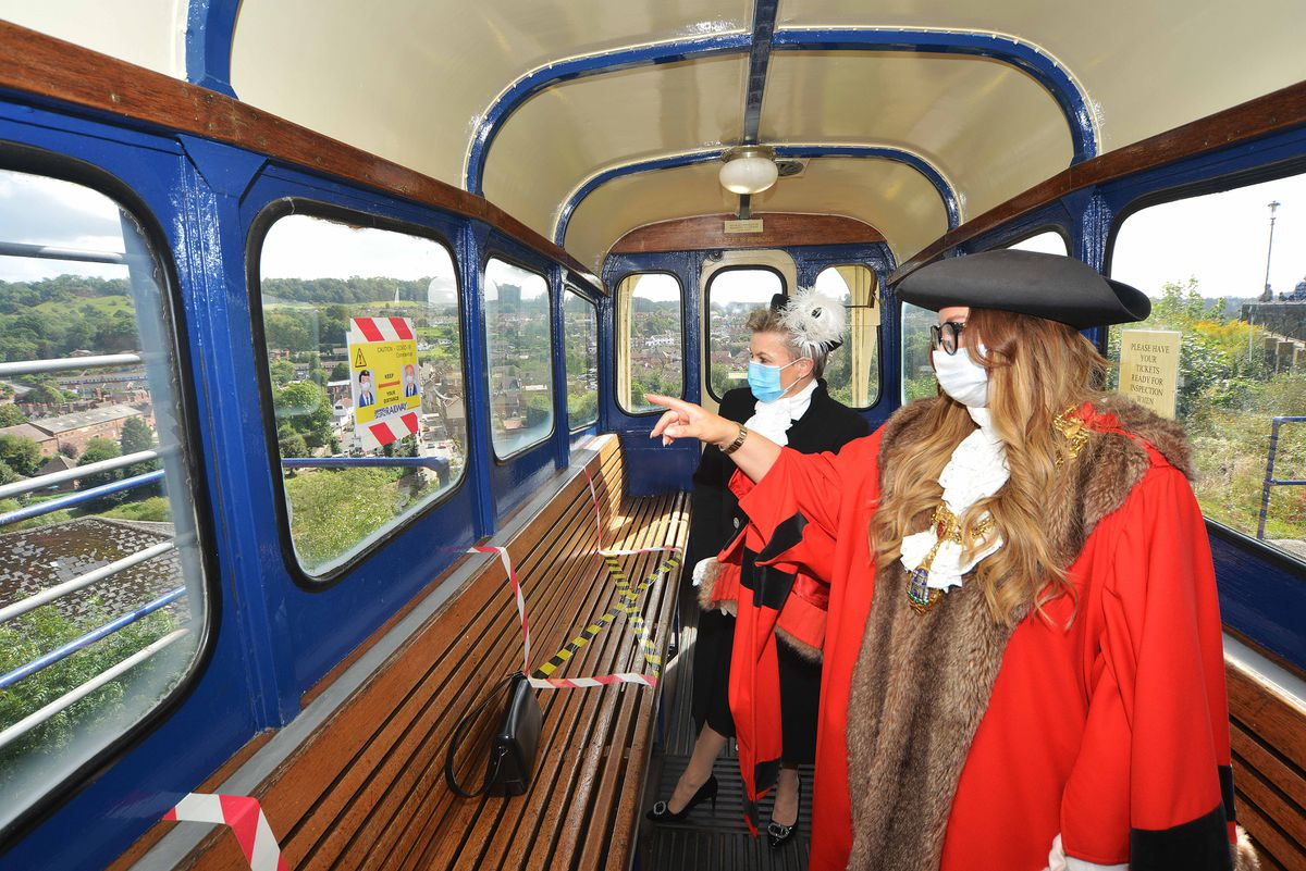Dean Harris, the High Sheriff of Shropshire and the Mayor of Bridgnorth Councillor Kirstie Hurst-Knight looking at various areas of the Cliff Railway top station