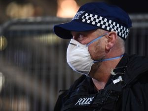 A police officer outside St Thomas' Hospital in central London as Prime Minister Boris Johnson was moved to intensive care after his coronavirus symptoms worsened. PA Photo. Picture date: Tuesday April 7, 2020. Mr Johnson, 55, was admitted to St Thomas' hospital in central London on Sunday after his coronavirus symptoms persisted for 10 days. Having been in hospital for tests and observation, his doctors advised that he be admitted to intensive care on Monday evening. See PA story HEALTH Coronavirus. Photo credit should read: Victoria Jones/PA Wire.