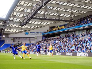 Brighton and Hove Albion fans adhering to social distancing measures in the stands