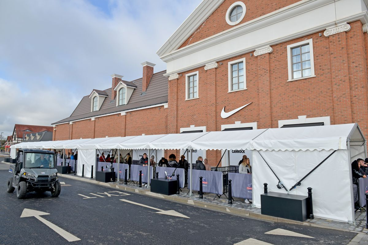 Shoppers arrive at the newly-opened designer outlet at Cannock